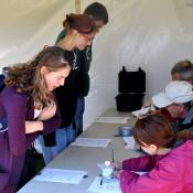 Arboretum-volunteers-register-participants-for-carving-contest
