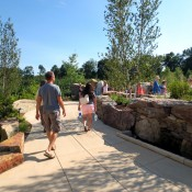 "Visitors entering ""Rocky Ridges"" area in Childhood's Gate Children's Garden"