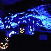 Painted wall and jack-o'-lanterns in the Limestone Cave (Children's Garden)